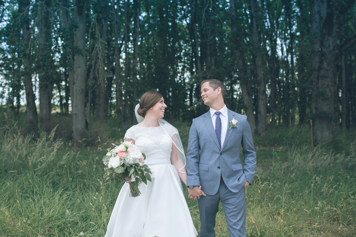 bride and groom portrait in trees