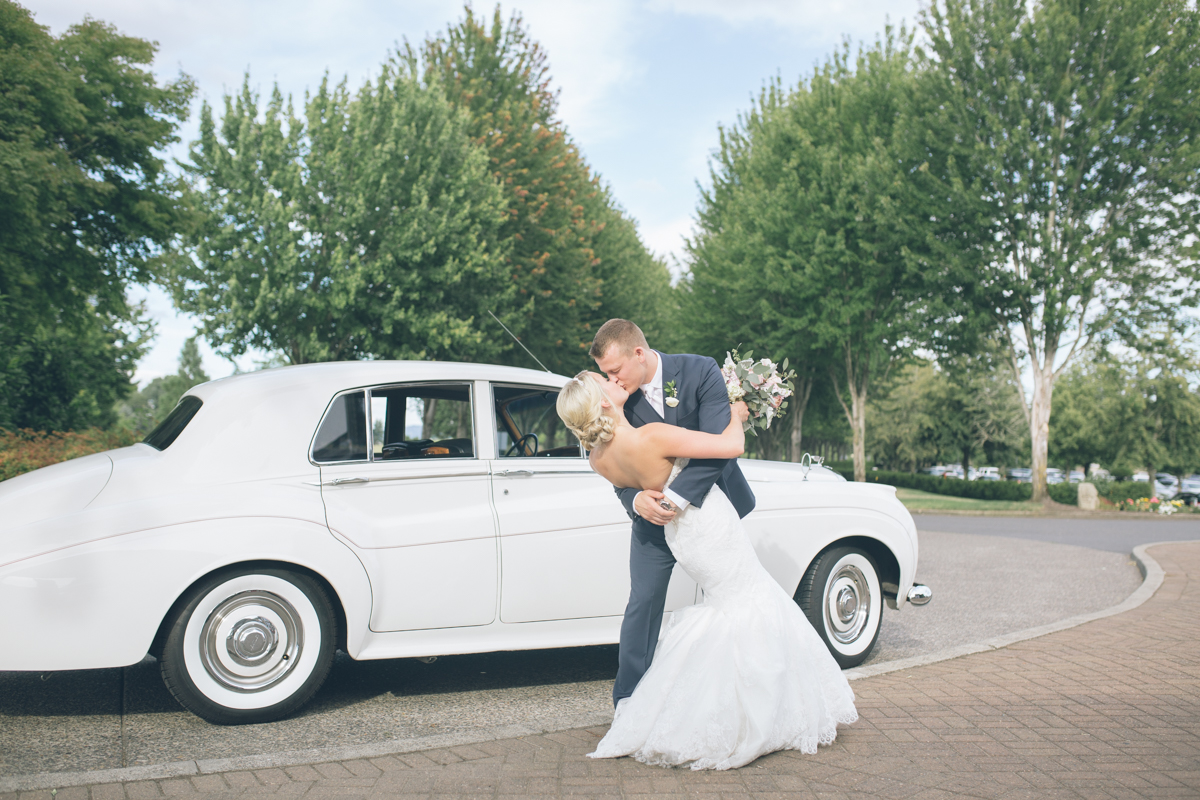 bride and groom kissing in white limo