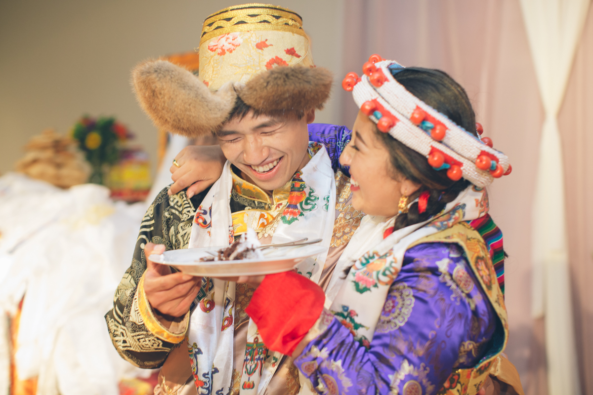 tibetan wedding bride feeding cake to groom