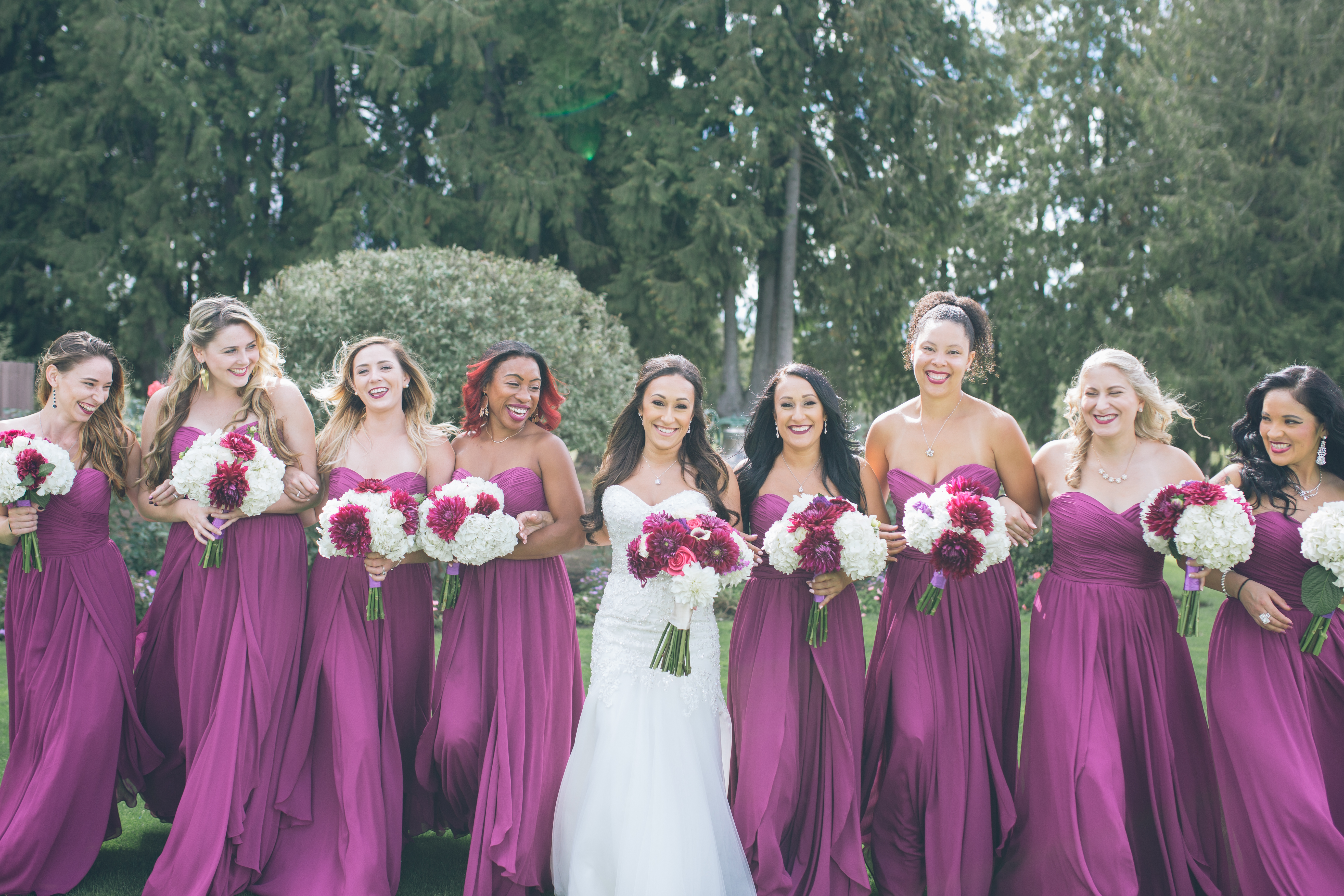 bride and bridesmaids in purple dress at golf club wedding oregon