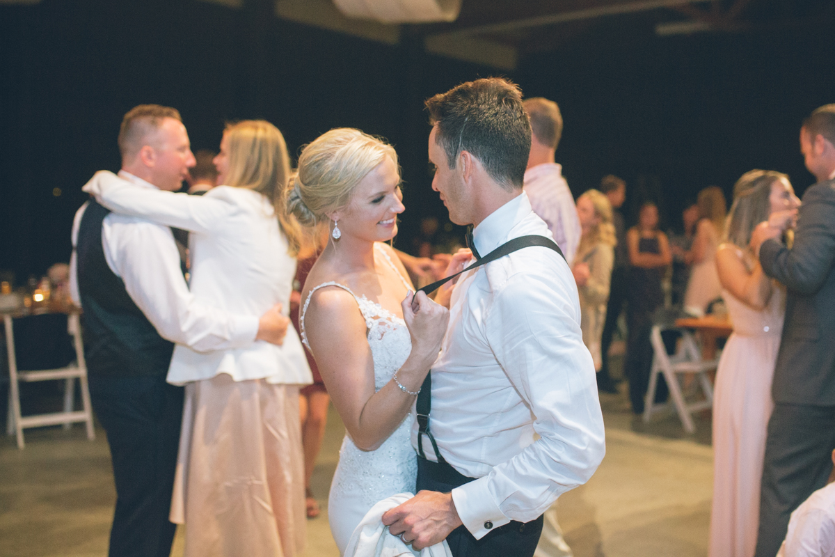 bride and groom dancing at barn wedding reception