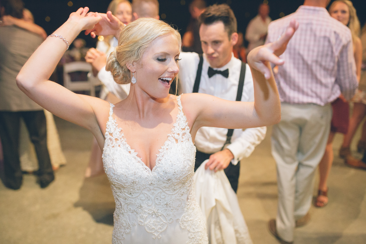 gorgeous blonde bride dancing at her wedding reception