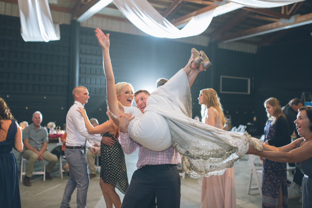 bride lifted in air by guests