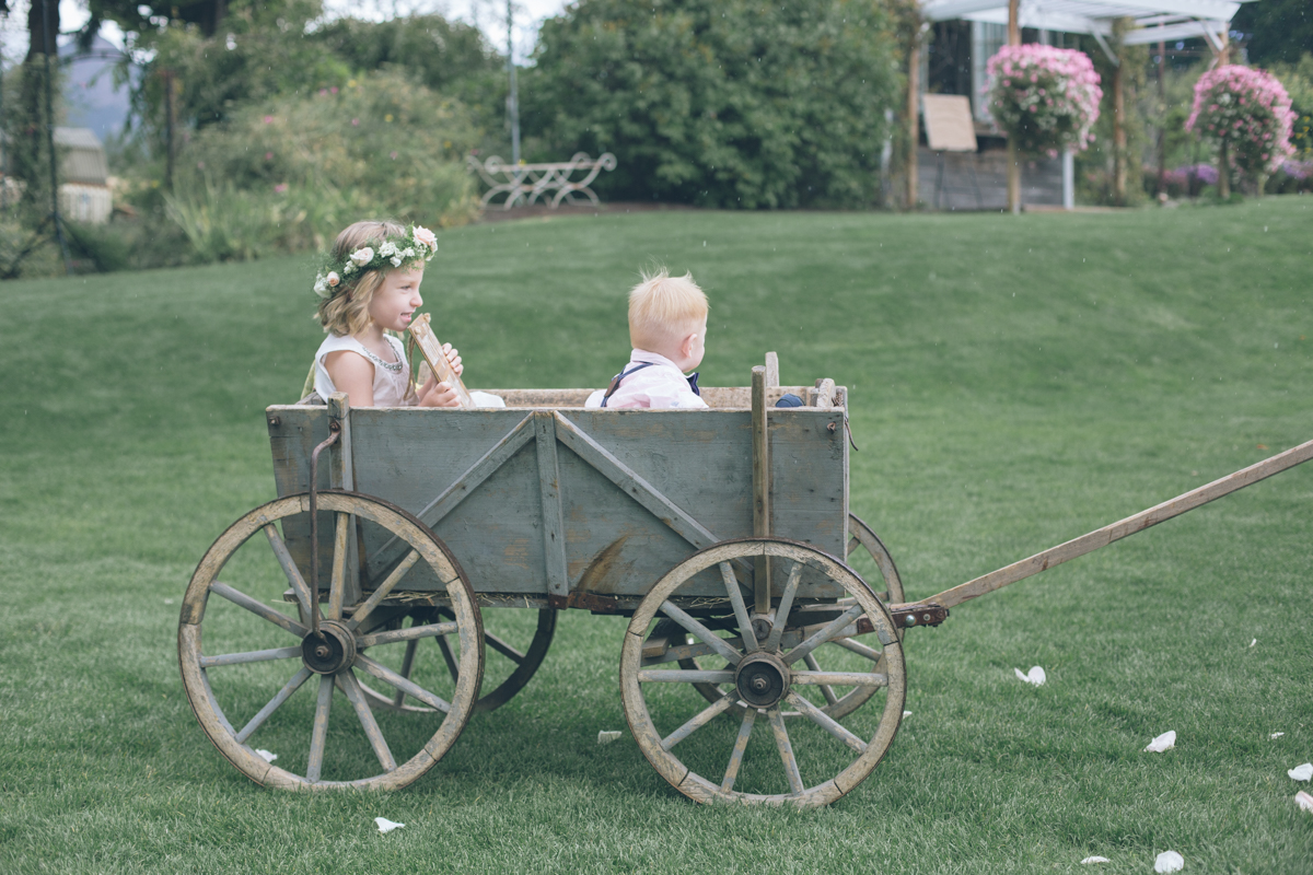 cute kids at barn wedding ceremony