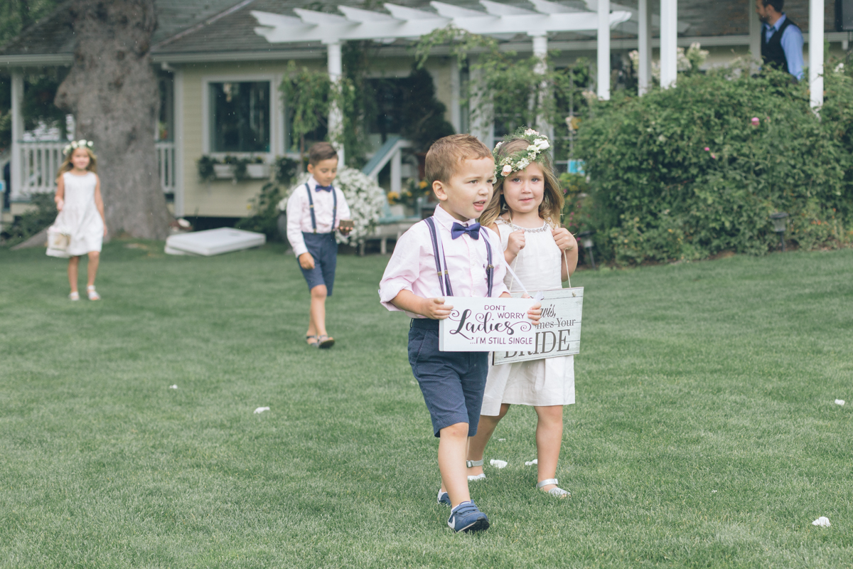 adorable kids at outdoor barn wedding ceremony
