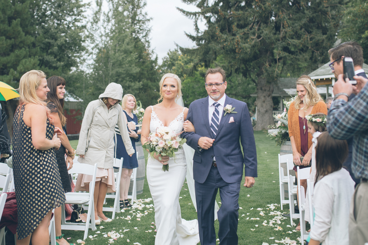 beautiful blonde bride walking down aisle with her dad