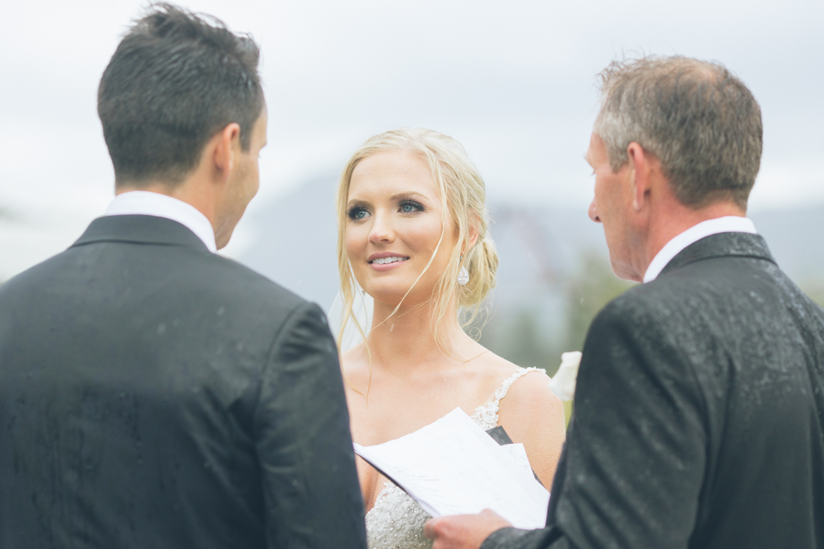 gorgeous blonde bride at outdoor rainy wedding