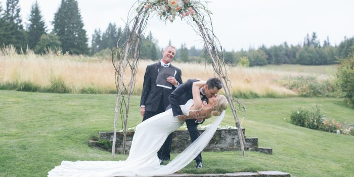 groom dips bride for first kiss
