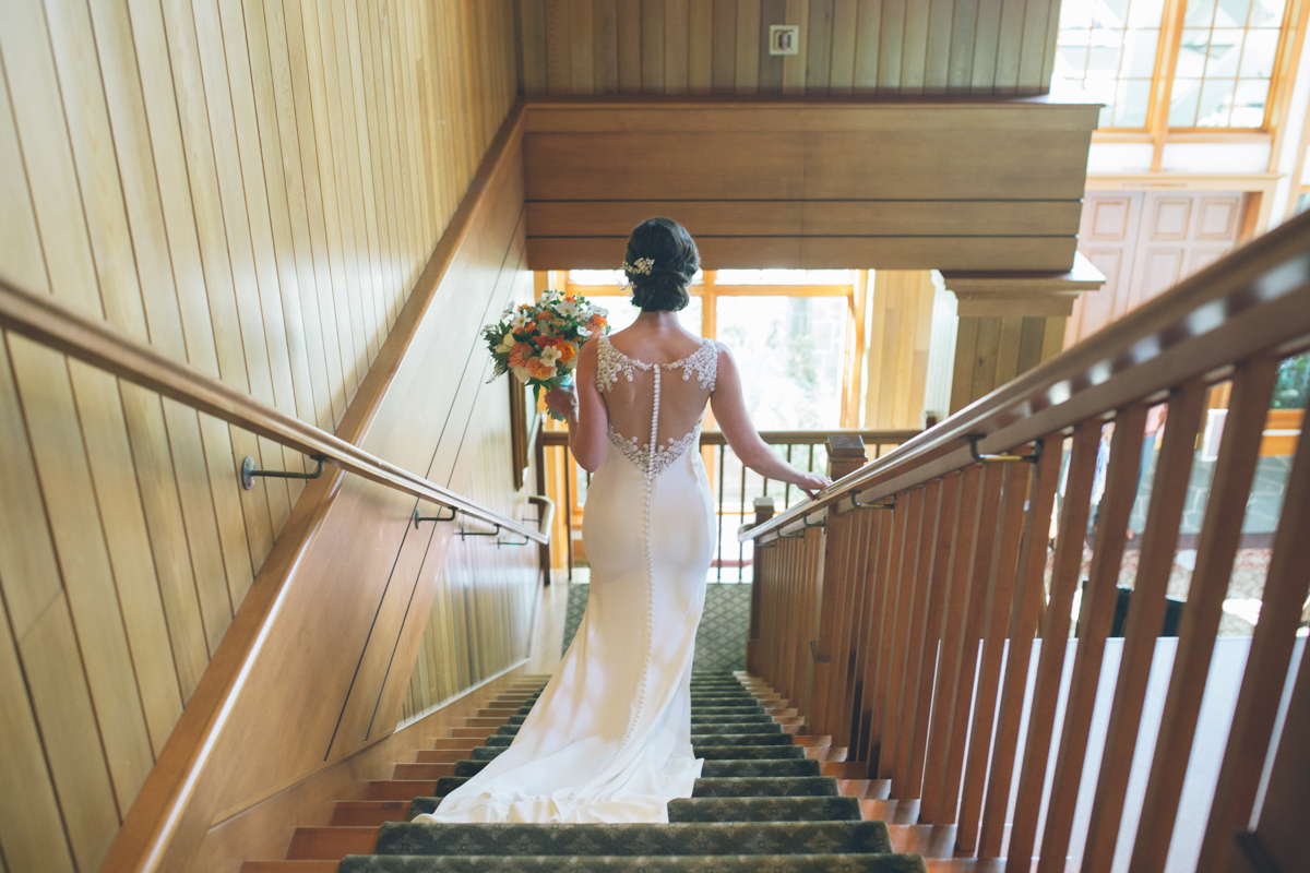 bride walking down stairs at oregon golf club wedding venue