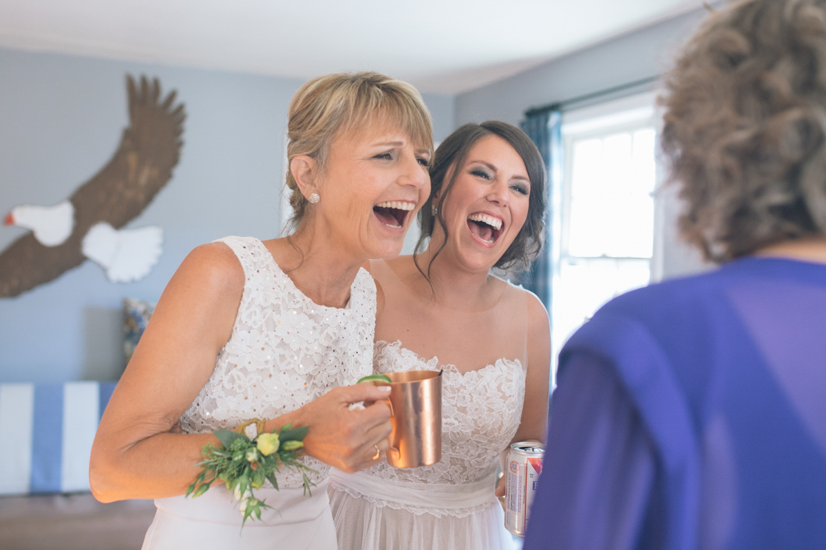 bride laughs with her mother and mother in law