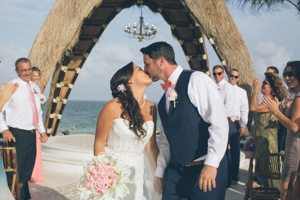 bride and groom first kiss cancun wedding