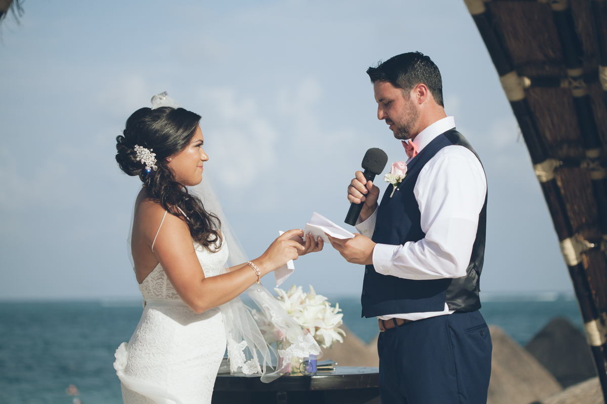 groom gives vows at wedding ceremony