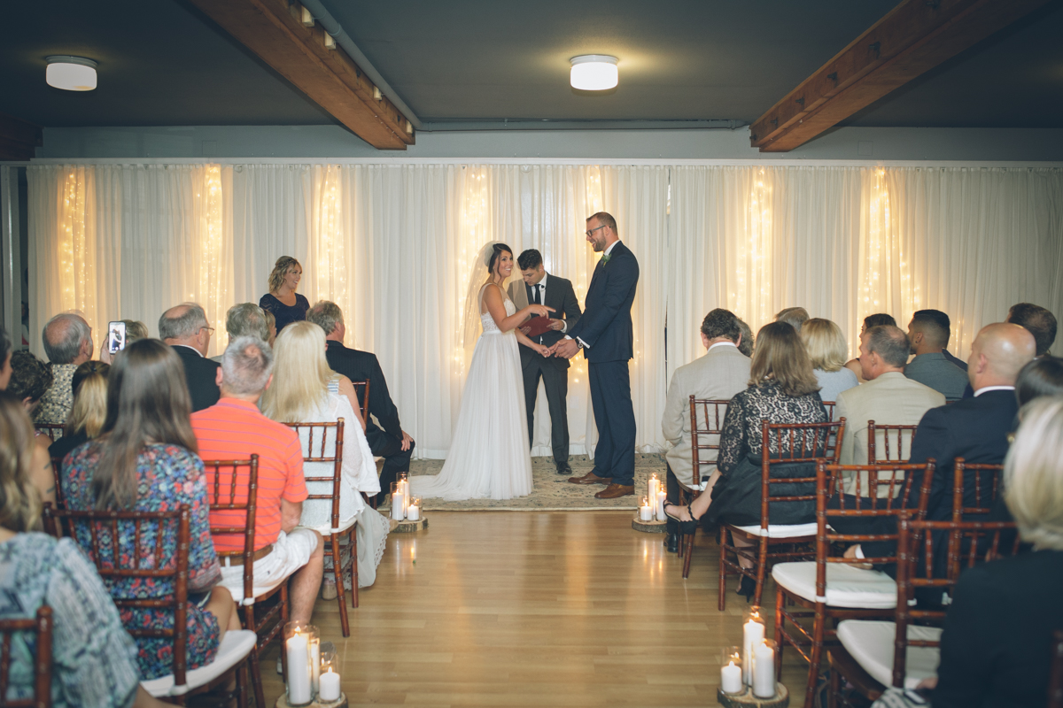 indoor wedding ceremony at the colony