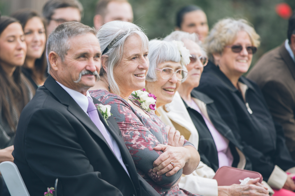 wedding guests smiling during ceremony