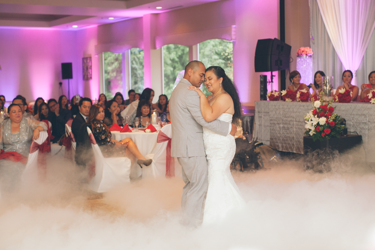 bride and groom first dance with fog machine