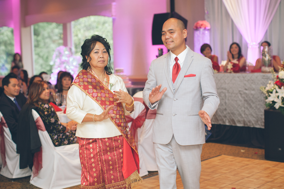 lao groom dancing with his mother