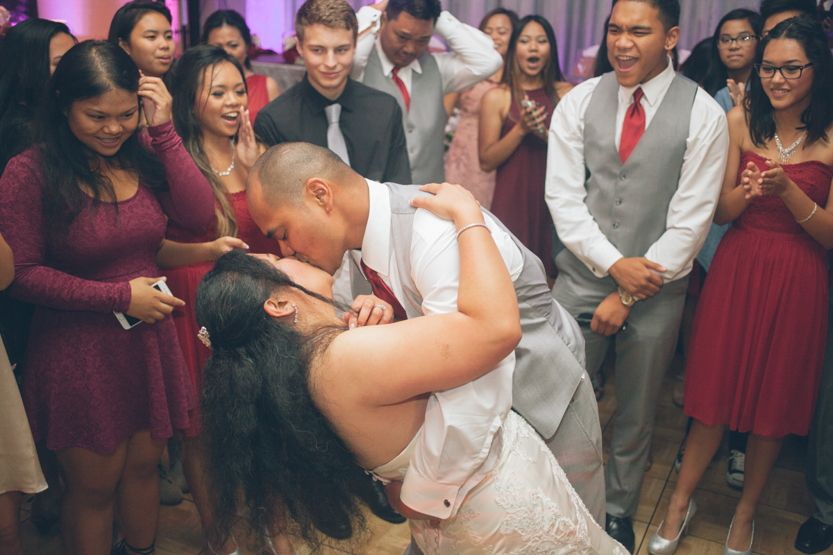 groom dipping bride on dance floor