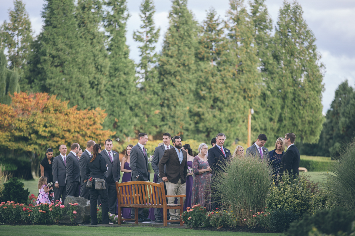 wedding guests walking to outdoor ceremony on lawn