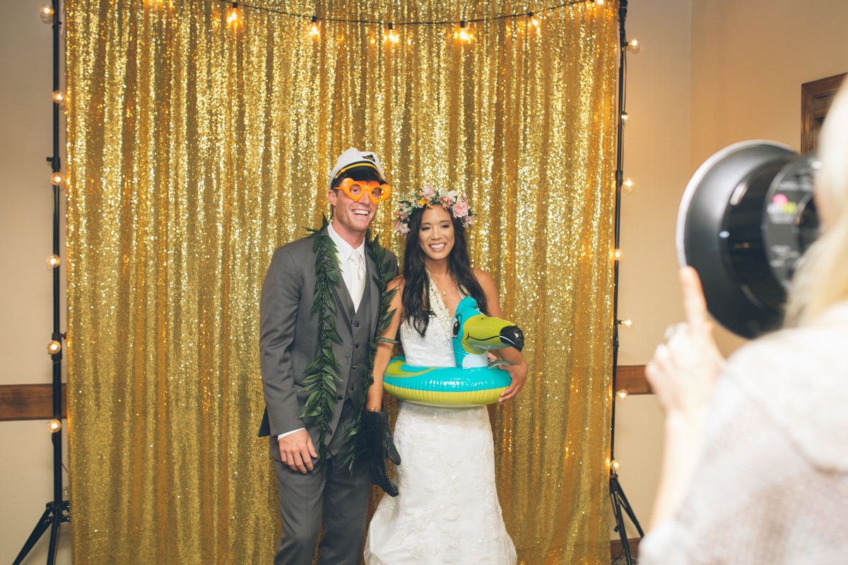 photo booth with gold backdrop