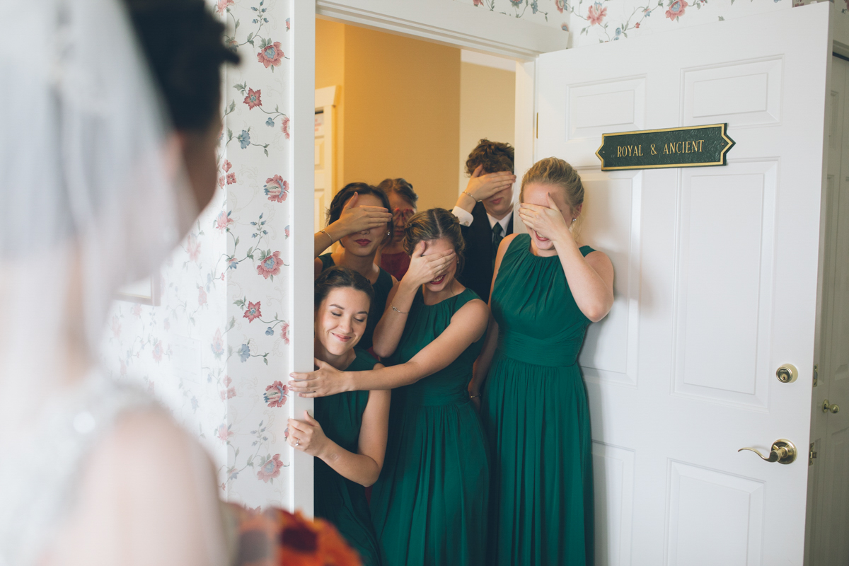 cute moment when bridesmaids see bride in wedding dress