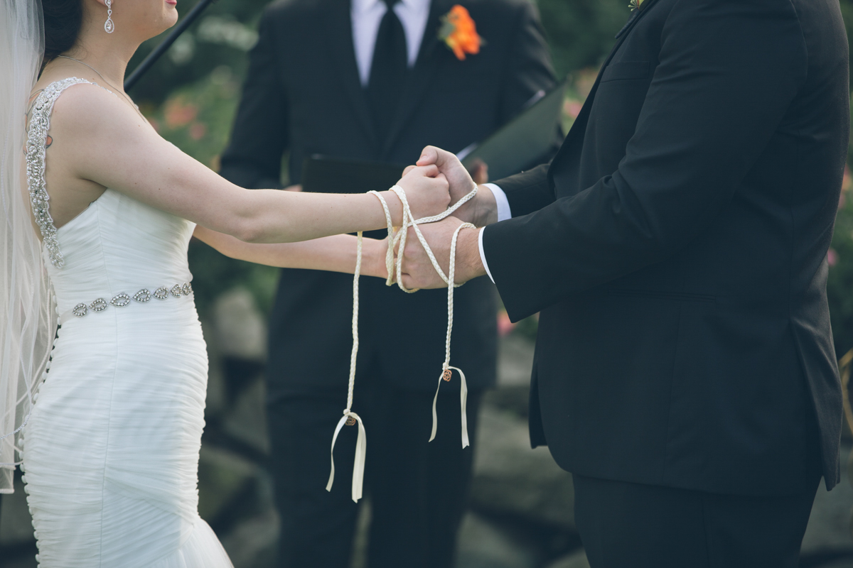 bride and groom hands tied wedding ceremony