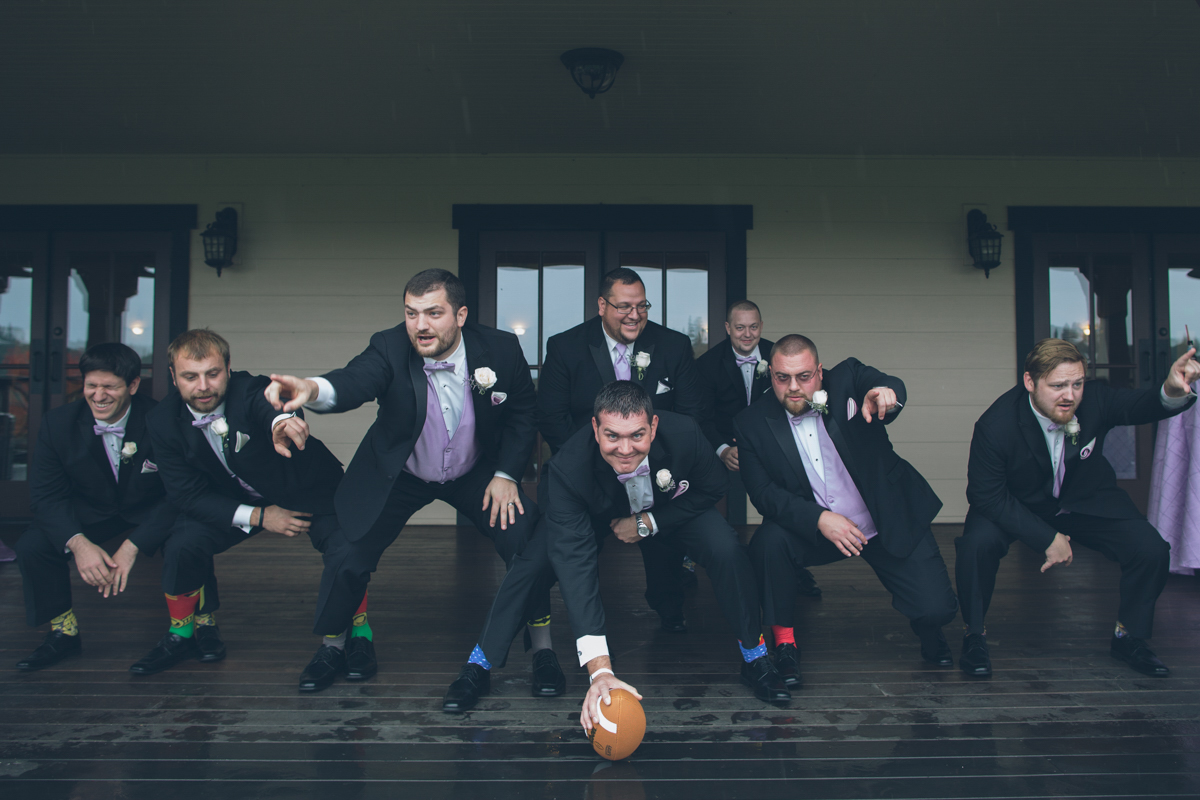 groom and groomsmen play football