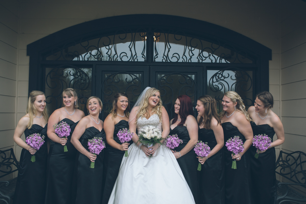 bride with bridesmaids at zenith vineyard